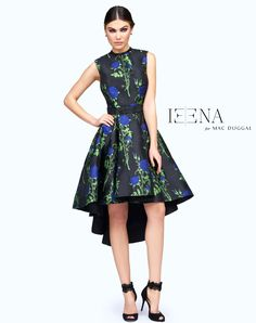 Take your floral obsession past the spring and summer seasons in this Ieena Duggal Blue Rose sleeveless, high-low cocktail dress. Sleek and prim with a detailed black beaded belt creating an A-line silhouette. This dress can be worn from day to night in the office or at your next special occasion.