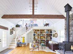 This Oklahoma living room looks mod and organized. Wood flooring makes for a farmhouse vibe.