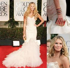 Hands down, Elle Macpherson stole the show in a corseted, ivory-silk Zac Posen gown with an eruption of tiered tulle at the hemline.  She smartly added a P.O.C. (pop of color) with a gold clutch, scarlet and gold bangles, and statement earrings.  It doesn't get any better than this.