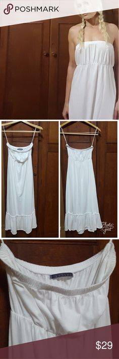 """Anthropologie White Strapless Summer Dress So pretty. Strapless, empire waist, ruffled detail at bottom. I did see 2 small yellowish marks on the front near the bottom that may come off. Otherwise in very good to excellent condition. 100% cotton. Elastic at top and waist. Approx 37.5"""" length, 12"""" across top, 11"""" across waist. Velvet by Graham & Spencer. Marked Petite so it's listed as S. For reference, I'm 5'6 and am a 34B with 27"""" waist. Anthropologie Dresses Strapless"""