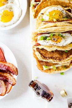 Light and fluffy pancakes act as a vehicle for thick slices of bacon, melted cheese, and fried eggs. Smother the whole thing in maple syrup and you have the best breakfast ever! Egg Recipes For Breakfast, Breakfast Tacos, Breakfast Dishes, Pancake Breakfast, Breakfast Ideas, Fried Avocado Taco Recipe, Light And Fluffy Pancakes, Pancakes And Bacon, Waffles