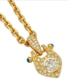 A Diamond, Sapphire and Gold Pendant Necklace, Gubelin, circa 1988  The pavé-set diamond plaque centering a round diamond weighing 1.15 carats, accented by a pair of cabochon sapphires, suspending from a belcher linking chain, pendant detachable, mounted in 18k gold, length 17 1/2 ins, chain clasp with maker's mark for Gubelin, pendant with French assay mark