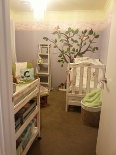 Garden theme nursery! We hand painted the tree and added ceramic butterflies! The wall colours with wall paper border represent sunshine above the clouds and purple grey sky below. The tree is more permanent than a decal, but so much more realistic and personalized! I'm in love with this sanctuary for our baby ♥