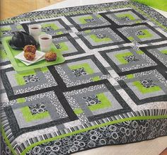 quilts-love the color combo-greys, black, white and lime green.