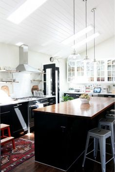 Bright Kitchen With Butcher-Block Countertops And High Ceilings