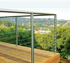 Horizontal cable rails are popular not only for their sleek, contemporary look but because the thin cables are almost invisible. Many cable-rail companies sell pre-engineered railing systems complete with surface-mounted posts and cable runs.