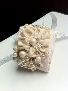 This One Of a Kind bridal wrist cuff was created from nearly all vintage materials and costume jewelry. Only 2 studs and ribbon are new.
