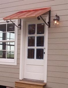 THE CLASSIC AWNING The Classic Awning blends effortlessly as it protects your door or window from mother nature. This is a metal door awning that looks great wi Metal Door Awning, Copper Awning, Front Door Awning, Porch Overhang, Porch Awning, Diy Awning, Window Awnings, Front Door Canopy Diy, Metal Awnings For Windows