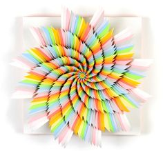 """you used to use construction paper in elementary school - well Jen Stark kept using it and these are the results. Shown """"Speed of Light"""" 12 x 12 hand cut paper on wood backing, 2008"""