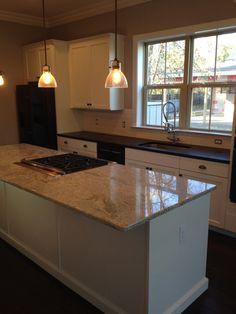 Lowcountry kitchen Black honed granite White subway backsplash