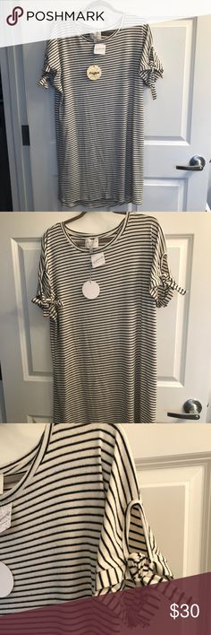 NWT Hayden Striped Dress with Tie Sleeves Size L Thank you for checking out my listing on this Brand new Hayden Striped Dress with Tie Sleeves.   - Cream/Black Striped - Ties at Both Sleeves  - Super Soft comfy fabric - Size Large - Brand New with Tags, never worn!  Reasonable offers welcome!   Any questions, please ask! Hayden Dresses