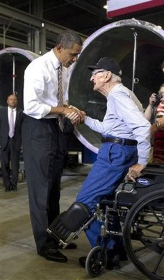 President Obama greets veteran Archie Hackney, from Des Moines, Iowa, and the 90 year old veteran insists on standing as a show of respect. Bravo! R-E-S-P-E-C-T
