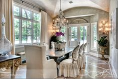 Gorgeous dining room.  Love the pattern on the hardwood floor, and of course the chandelier