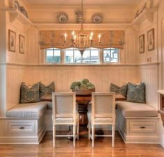 Gorgeous built in eating alcove, white country kitchen with chandlier