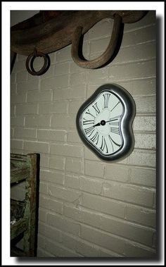 Kirch George Nelson Melted Metal Dali Clock by Kirch, http://www.amazon.com/dp/B001J7QNEK/ref=cm_sw_r_pi_dp_EXZZqb0BAZDWB
