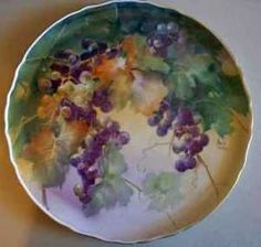 Grapes on porcelain plate by porcelain and watercolor artist and teacher, Paula White
