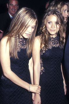 Mary-Kate and Ashley Olsen pair LBDs with straight and curly hairstyles at the Academy Awards after-party.