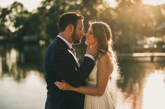 animated gif of bride and groom kissing in front of Lake Hiawatha near Tampa