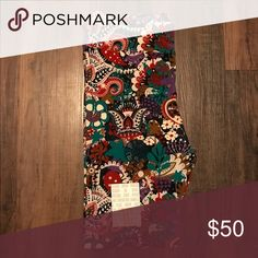 Lularoe TC colorful Paisley Leggings BNWT Purple, red, teal, white, brown, and black paisley. Tall and curvy leggings fit size 12 to 20. Brand-new with tags. Hard to find. Unicorn. Will ship within 24 hours of purchase. LuLaRoe Pants Leggings