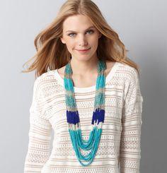 I like the necklace and i like her smirk