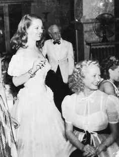 Bette Davis & Miriam Hopkins at Bette's party.