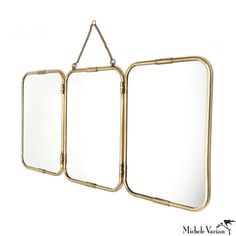 Vintage style, rounded edge brass mirror. Hangs from chain. 33.5 inches x 15.5 inches x .5 inch