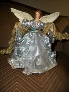 Gold and Silver Angel Tree Topper , http://www.amazon.com/dp/B00AVWVRD6/ref=cm_sw_r_pi_dp_llL1rb11K44PT