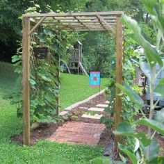 the story of our grape arbor, tells you how to make this simple grape arbor with 4x4s aand 2x4s