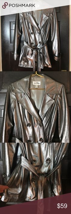 Joseph Ribkoff silver stretchy trench coat 6 Joseph Ribkoff stretchy silver belted trench coat size 6. Great condition. There are a few tiny worn spots on the coat which are not or barely noticeable but shown in the one close up photo. Jospeh Ribkoff Jackets & Coats Trench Coats