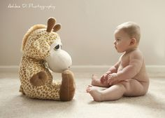 Cute 6 month baby photo - you should totally do this with the giraffe Travis bought...maybe monthly?