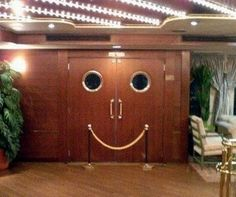 "Cheerfully welcoming doors -- from ""Inanimate Objects With Faces"""