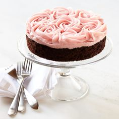 Rose Chocolate Cake topped with whole fluffy pink buttercream roses.