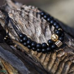 Simba is a set of handmade men's bracelets that includes 2 bracelets made with matte black agate beads which are grounding and protective stones that also bring the wearer peace and inner strength. The bracelet also includes black cubic zirconias and a 24k gold plated zamak lion head charm which symbolises strength, power, instinct, protection and loyalty. Both bracelets are made with adjustable sliding knot closures.