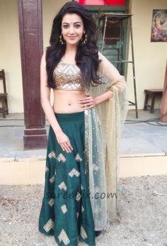 "Kajal Agarwal in lehenga photos at ""Sardar Gabbar Singh"" movie sets. She looks eye catchy in mirror embellished gold and green lehenga. Wavy hairstyle and Green Lehenga, Lehenga Choli, Lehnga Dress, Saree Blouse, Lehenga Designs, Indian Attire, Indian Wear, Indian Dresses, Indian Outfits"