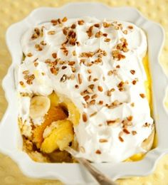 1. Line a 13×9 pan with strips of Angel Food Cake. In a sauce pan over medium heat, mix sugar and pineapple together and bring to a boil. Let reduce until slightly thick and pour over angel food. Let it cool a little. 2. Spread pudding over pineapple mixture. Slice bananas and place over pudding. Top with whipped topping. Then add the cherries and chopped pecans if you desire. Refrigerate for a few hours before serving and DIG IN