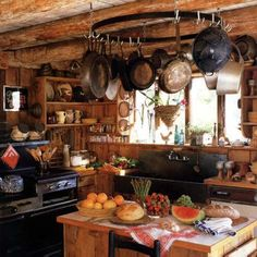 Another rustic kitchen with delicious fruit and knickknacks littering the small room...