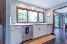 Kitchen Remodel, White Dove Cabinetry Paint Color, White Ice Granite, Bamboo Hardwood Floors | construction2style home renovation