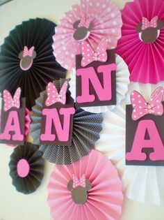 Minnie mouse party table backdrop paper fans pink, black, white pinwheels on Etsy, $30.50