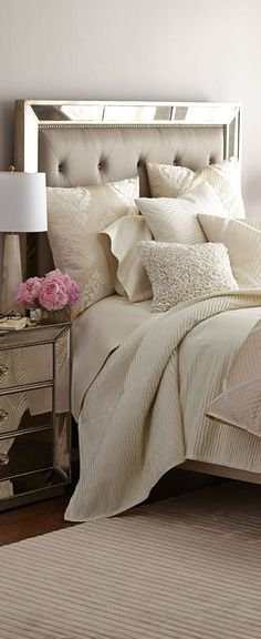 Bed,Bath and Beyond has a tone on tone natural color bed set on display and it's beautiful. Quite elegant as this one is with the mirror and night stand.