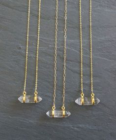 Quartz crystal plated in gold on a custom length gold filled chain. Choose from two chain styles: link or cable chain. Great necklace to layer with other pieces or to wear alone.