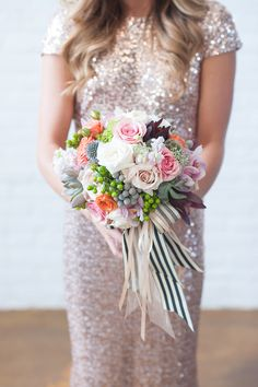 This ribbon combo is so great and carried for bridesmaids.  Love how it pulls out different colors in the bouquet