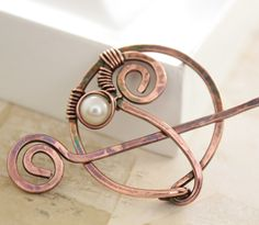 Penannular shawl pin or scarf pin in swirly design with a white pearl