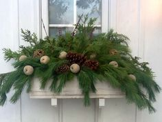 Easy winter window box with dollar store ornaments. Little Brown Dog Design.