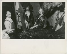 Showgirls and stagehands backstage during a Billy Rose stage production.