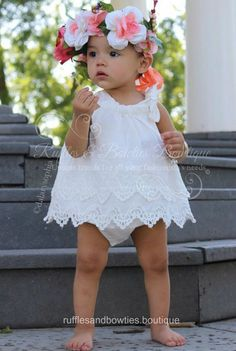 This stunning romper is white in color, with delicate tiered lace giving it the sweetest of vintage looks. A ruche neckline with bow finishes this item off just