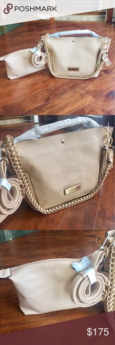 🔥 2 NWT Andrew Marc 5 in 1 Purses Beautiful and versatile 5 in 1 purse! This purse has gorgeous textured faux leather material and super soft interior lining. Mix and match straps with small purse and large tote. Can be worn: main bag with short strap, main bag with chain strap, inner bag with chain strap, inner bag with short strap, or inner bag with shoulder strap. Inner purse has one zip pocket and two open pockets. Main bag has two pockets on the outside. Andrew Marc Bags Shoulder Bags