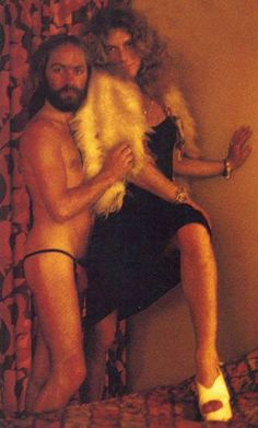 Classic photo of Robert Plant in drag with Roy Harper.