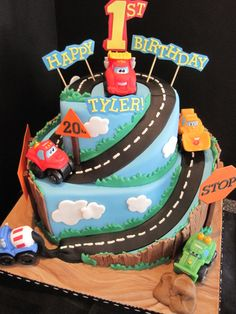 Chuck N Friends - First birthday cake for a little boy who loves trucks.  the trucks are toys but all other features are edible with either fondant or gumpaste.