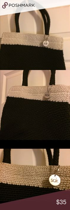 Pocketbook NWOT beautiful black with white band at top. This is a classic Sak purse in great condition. Never used. The Sak Bags Totes