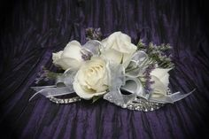 White spray roses, caspia and rhinestones in a white sheer bow on a silver corsage bracelet by Emil J Nagengast Florist, Albany, NY. #prom #corsage